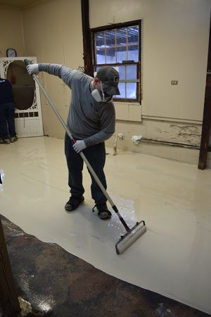 A beige pigmented ultra-low VOC polyaspartic basecoat was applied to the bakery floor at 15 mils thickness. Courtesy of Covestro LLC.
