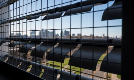 Logan airport garage's dynamic façade features 48,000 metal panels finished by Linetec