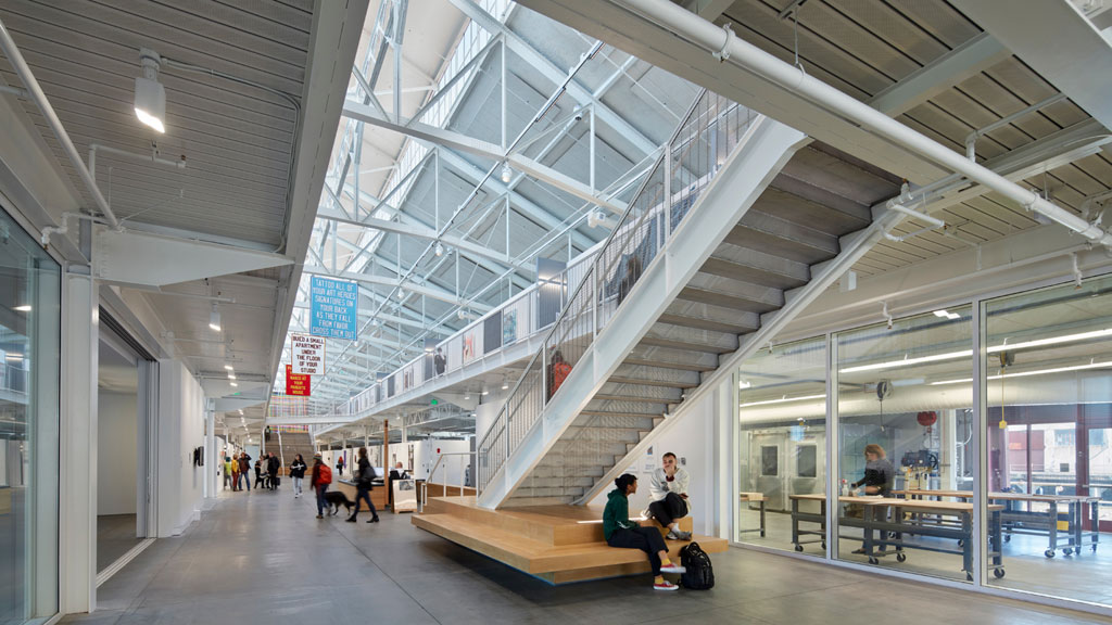 Central atrium and clerestory light monitor with workshop visible to the right and student gallery and media theater to the left. Image: © Bruce Damonte