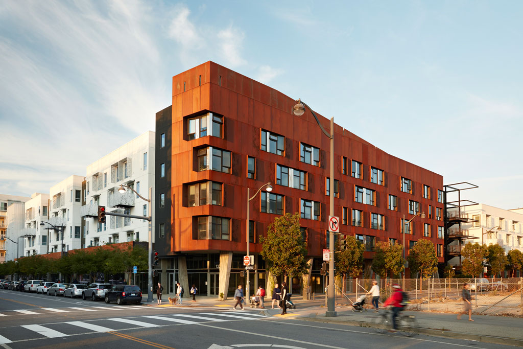"""The largest new 100% affordable development to open in San Francisco in a decade, this building establishes a gateway to a new neighborhood. Bringing almost 200 family homes and retail space close to downtown, transit, a medical campus, and a future park, the affordable building's rich details—custom weathering steel, textured concrete """"dancing columns""""and a """"napkin ring"""" stair tower set to hold giant bamboo—set a welcoming tone. Five88, San Francisco 