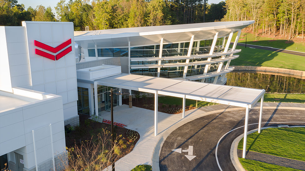 Yanmar Corporation's headquarters in Atlanta, Ga. gives a nod to nautical style with a dramatic 35 ft., three-sided conical-shaped curtain wall. Courtesy of YKK AP America Inc.