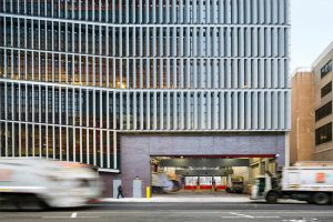 New York Sanitation Building Wows with Perforated Solar Fins Enriched with Lumiflon FEVE Resin. Photo credit: Albert Vecerka/Esto