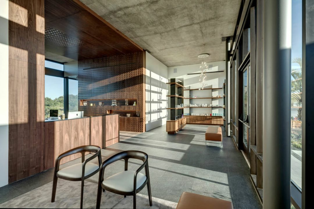 Once inside, natural daylight from a skylight is filtered through the layering of a perforated and parametrically designed wood screen. Credit: Charles Davis Smith