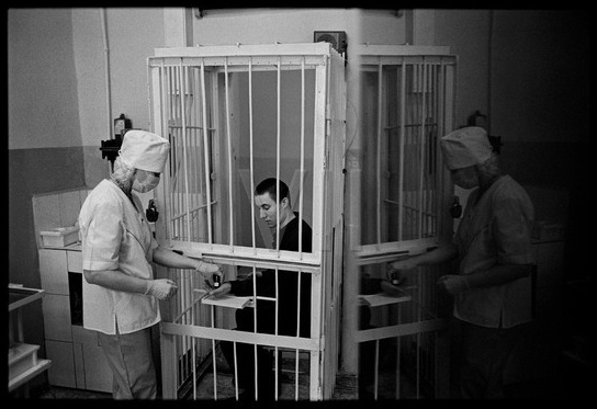 James Nachtwey, A TB patient/prisoner receives his daily oral medication at Correctional Treatment Unit #1, a TB prison colony in Tomsk, Siberia.