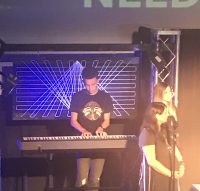 Carson in action with Worship Leader (and WCA Music teacher) Chelsea Meisinger