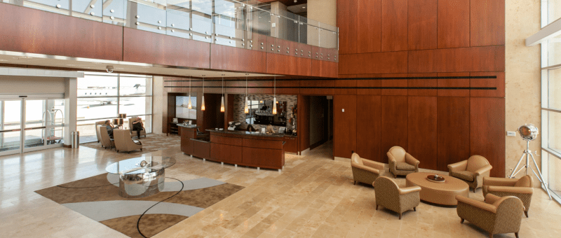 What is an FBO lounge for private jets?