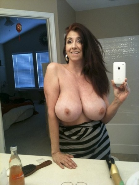 One Reason I Love Milfs They Usually Have Nice Big Titties This Milf Babe Certainly Doesnt Disappoint In The Chest Area Shes Got Massive Natural Boobs