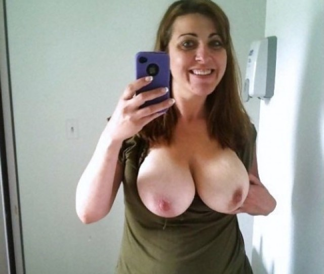 Amateur Milf Taking A Pic Of Her Big Natural Boobs