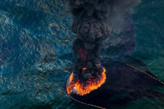 Oil Spill #1: A plume of smoke rises from a burn of collected oil. A total of 411 controlled burns were used to try to rid the Gulf of the most...