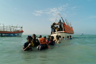 Somali refugees departing Shimbiro Beach to board smugglers' boats to Yemen