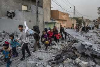 Early morning in the Jadidah neighbourhood of west Mosul, civilians flee heavy clashes between Iraqi special forces and ISIS militants.  2017