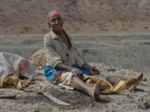 Meru woman mining salt, Magado Crater, neighbouring  Nakuprat -Gotu Conservancy