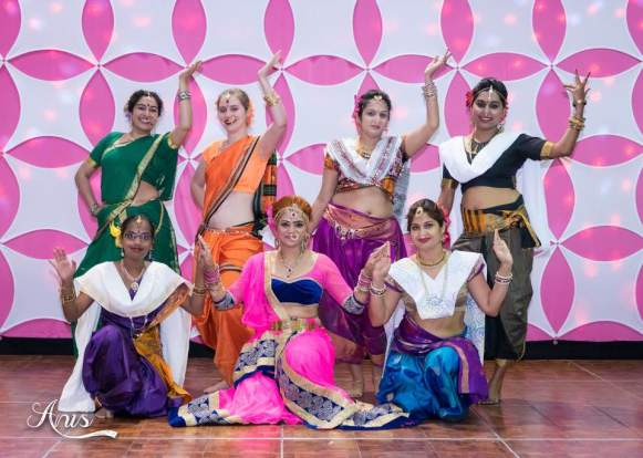 Bollywood Dance and workout in Morrisville NC, Best Bollywood Dance Teacher Raleigh Cary Durham North Carolina, Greensboro, Greensville, Clayton, Wilmington, Brunswick, Chapel Hill, Apex, Wilson, Garner, Winston-Salem, parties, children birthday hostess, bachelorette, bridal shower, wedding, baraat, sangeet, special event dancer, dance workshops, school international festivals, Indian, Arabic, foreign cultural dance, Genie, Shimmer & Shine party, Aladdin, Jasmine dance, Disney princess, Jungle Book party, Genie dance, school workshops, corporate holiday party, business trade show dance performances, dance classes near me, raas garba, bhangra, lavni dance, Indian stick dance class, drama classes for kids