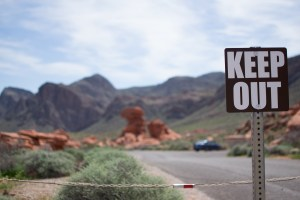 """""""Keep Out"""" sign on a baron highway"""