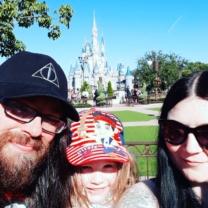 Walt Disney World Castle in the background with the author's family