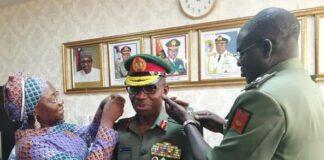 Lt Gen Lamidi Adeosun being decorated by General Buratai