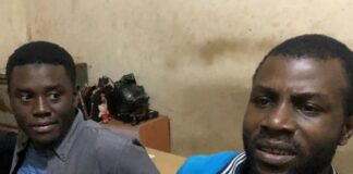 Gidado Yushau, Editor NewsDigest and Adebowale Adekoya, a Professional Website in Police Station after their arrest on an investigative report