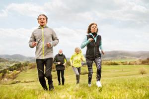 82729346 - group of seniors running outside on green hills.