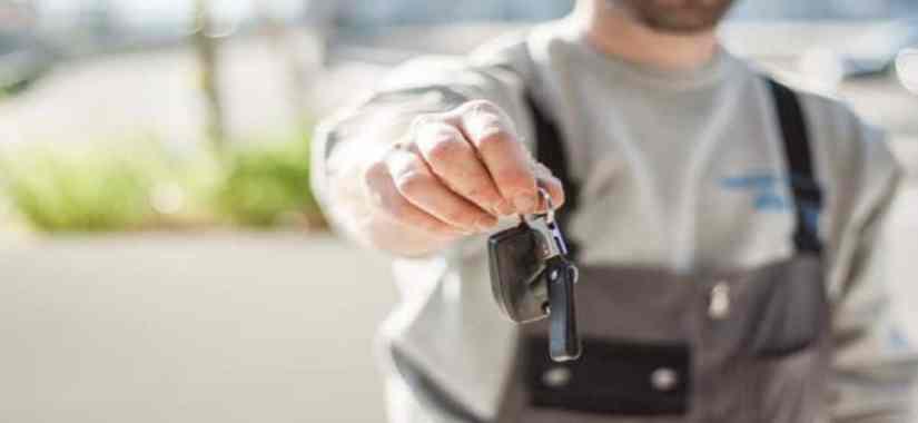 man presenting a car key fob