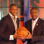 Ujiri and Casey holding a ball