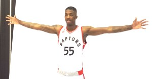 Delon Wright arms wide