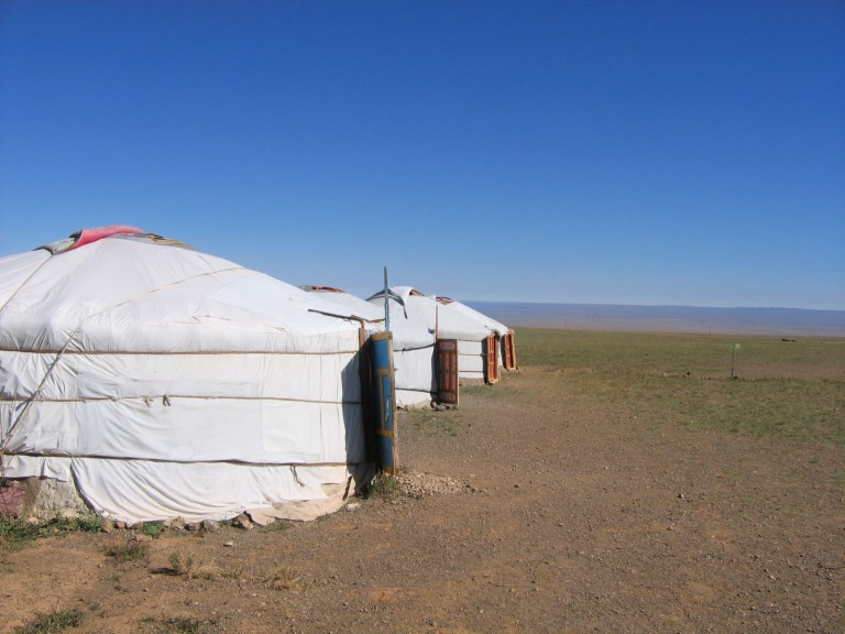 Stop in Mongolia and stay with local nomads in a ger tent when you travel the Trans-Mongolian Railway