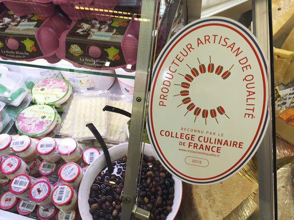 Do you look for an unique local experience in Nice? Try the food tour around Nice: You learn about the city AND get a taste of Nice on the Nice food tour. Even at the market, they wear the seal of quality, so you know the food is good.