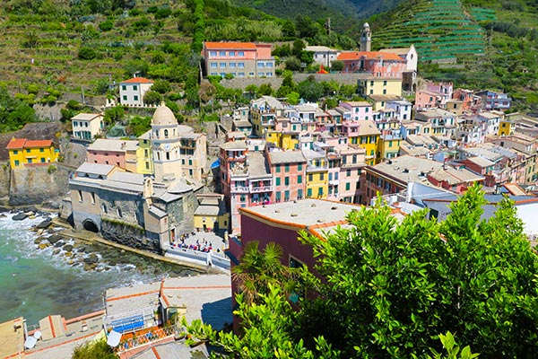 View on the colourful houses of Vernazza, how to get to Cinque Terre Italy