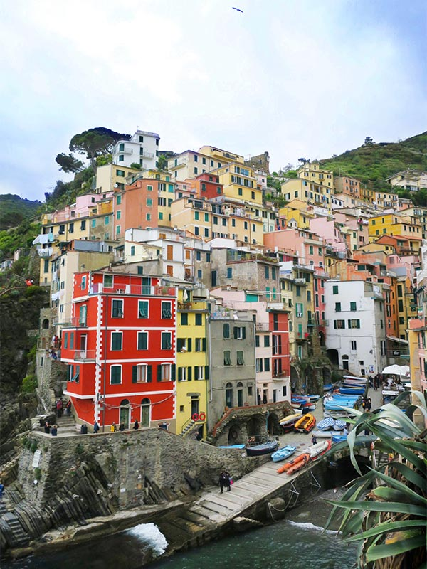 Colourful houses of Riomaggiore. How to get to Cinque Terre Italy?
