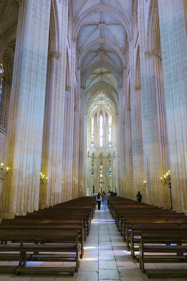 Explore the amazing monasteries of Alcobaca, Batalha and Tomar Convent of Christ in Portugal. Read about the Heritage Trail and why you should visit. I'll give you a ton of practical tips to visit these monasteries in Portugal from Lisbon.