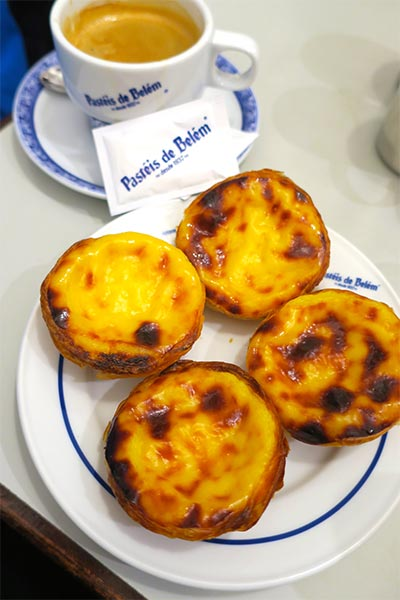 Delicious Pasteis de Nata at the famous bakery Pastein de Belem in Belem, Lisbon, Portugal