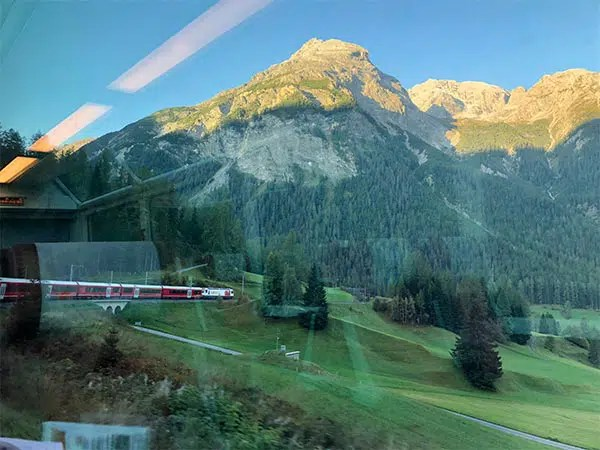 What if Glacier Express tickets are sold out? Read my pros and cons for travel on the Glacier Express vs the local Swiss train from St. Moritz to Zermatt.