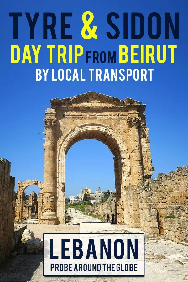 Ancient Roman Triumphal Arch in Tyre Lebanon against bright blue sky and in the distance more Roman ruins. Text overlay saying: Tyre and Sidon Day trip from Beirut with local transport Lebanon Probe around the Globe.