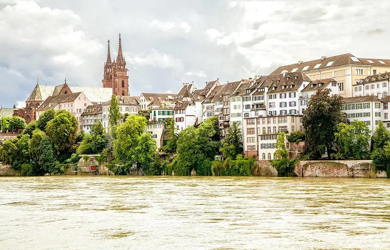 The River Rhine is a prominent feature in the city of Basel, one of the best cities in Switzerland you must visit.