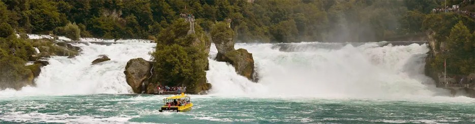 Boat tour in the middle of the Rhine River as the Rhine Falls at Neuhausen Switzerland.