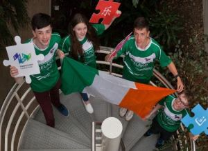 Members of Team Ireland pictured holding Irish flag and puzzle pieces