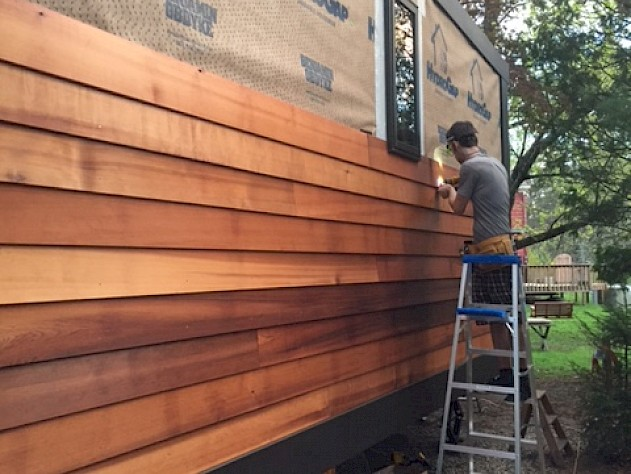 Doors And Trim Complete; Cedar Siding Started!