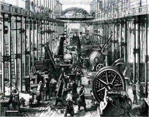 Obreros trabajando en un edificio industrial.