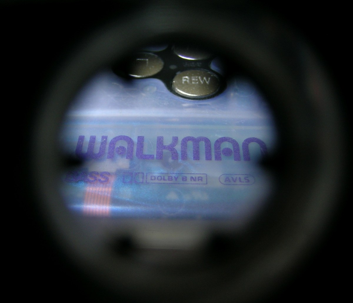 A photograph of a Sony Walkman taken through one of the two spools on the tape.