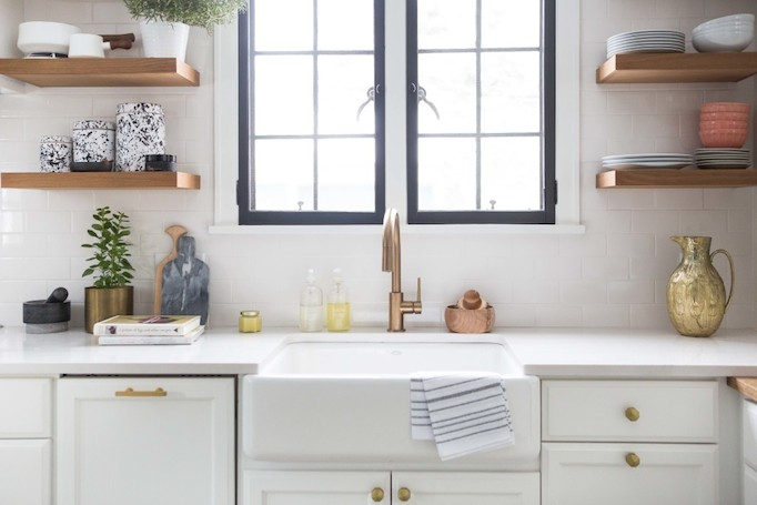 brass black and white cement tile kitchen