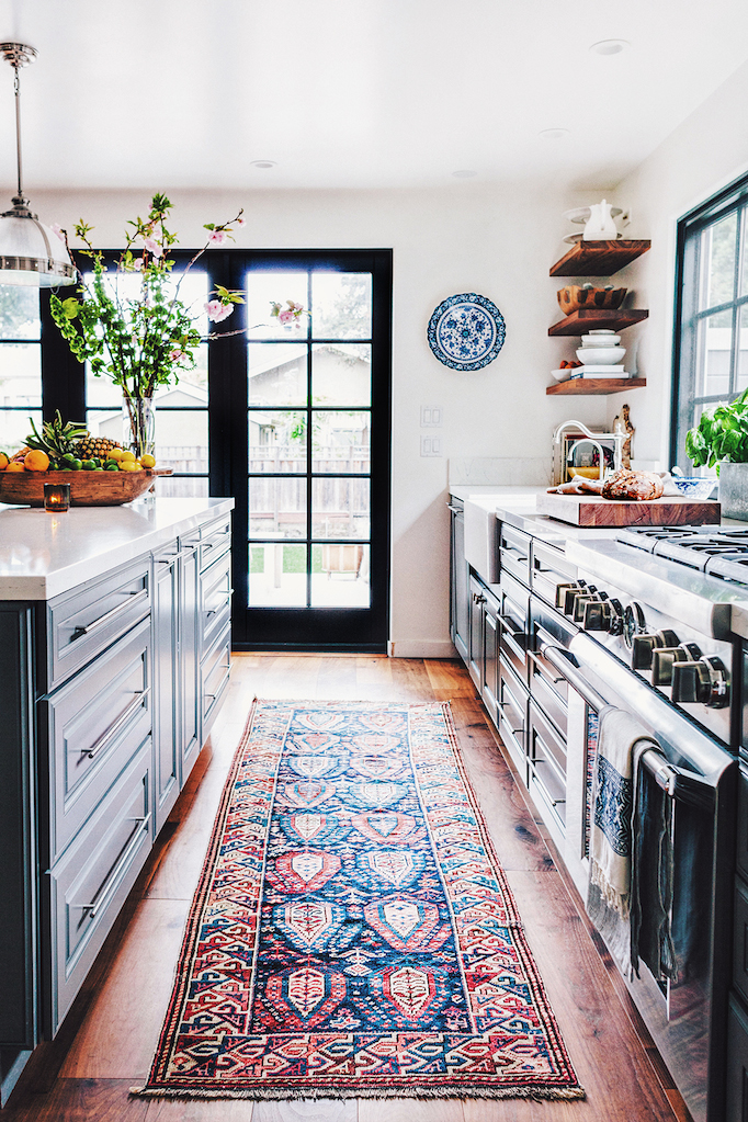 blue kitchen cabinetry antique rug