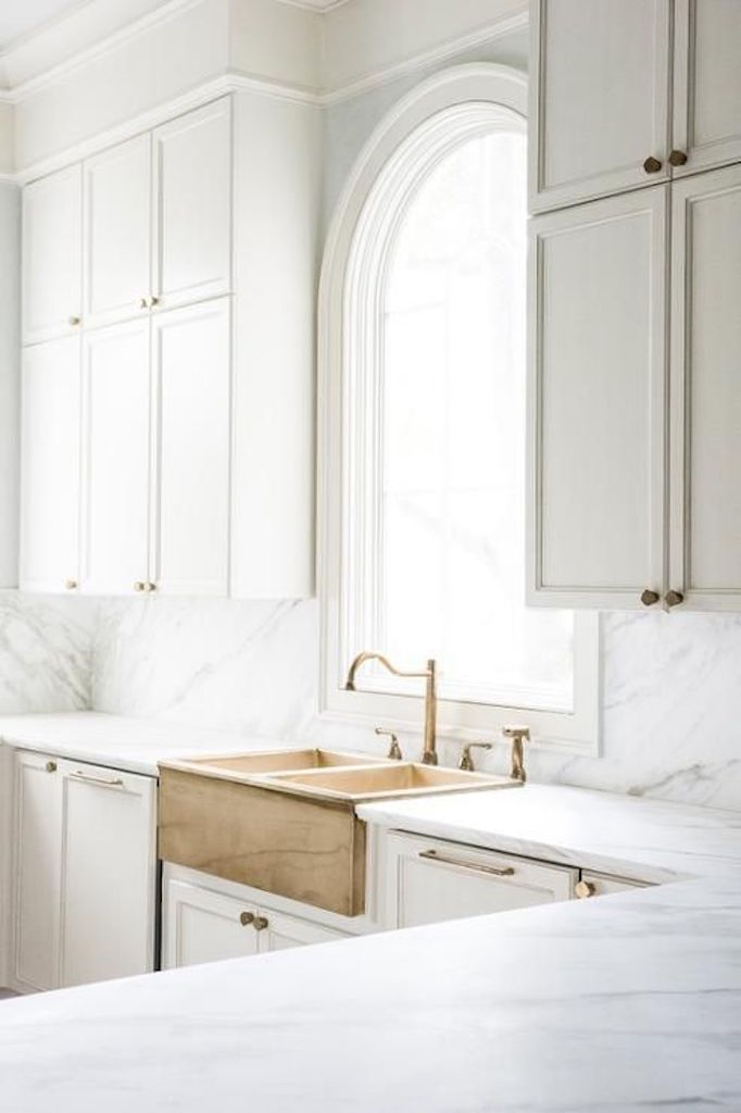 brass-apron-sink-in-white-kitchen