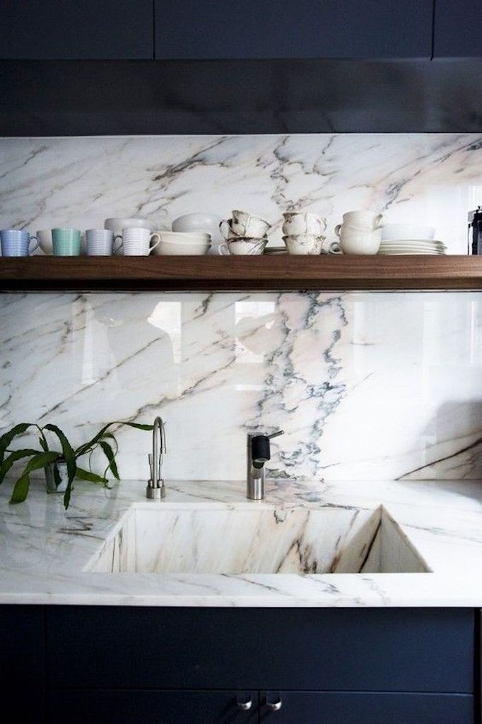 integrated-marble-sink-navy-cabinets