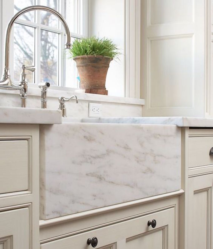 marble-apron-sink-cream-cabinets