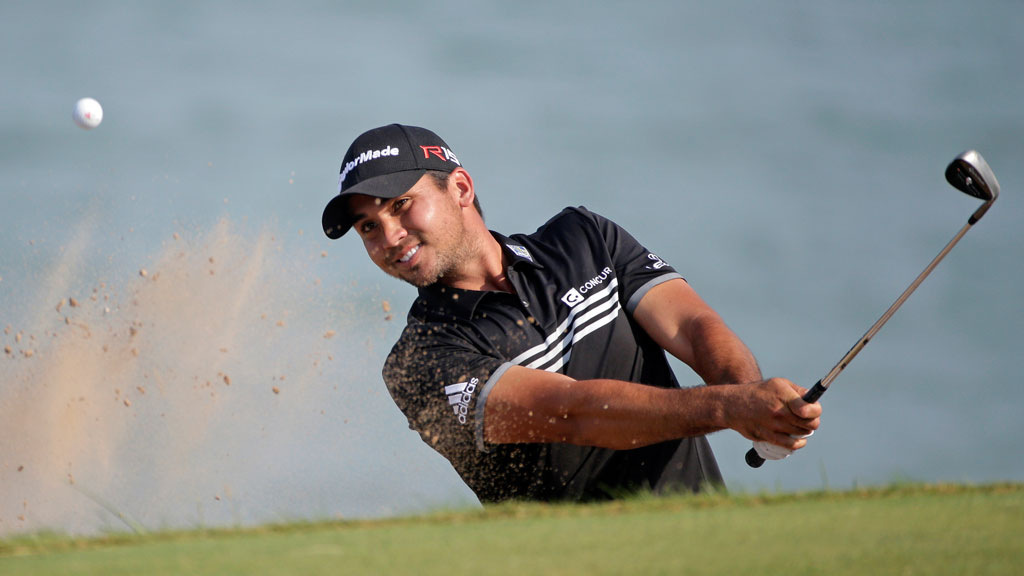 Jason Day hits out of a bunker on the 12th hole. (AAP)