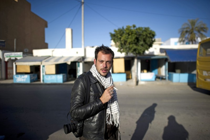 Undated  photo of French photographer Remi Ochlik as he was covering the Tunisian revolution,  who died Wednesday Feb. 22, 2012 in Homs, Syria.  French photojournalist Remi Ochlik  and an American working for a British newspaper Marie Colvin  were killed Wednesday  by Syrian government shelling of the opposition stronghold of Homs, France's government said.(AP Photo/Yoan Valat)