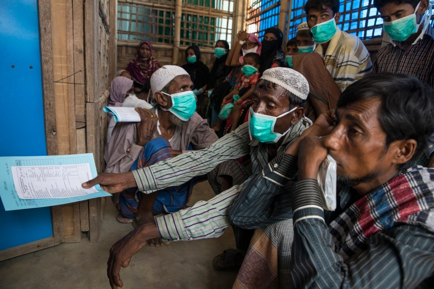 KUTUPALONG, BANGLADESH - OCTOBER 4: Patients wait for testing and medical treatment for tuberculosis at the 'Doctors Without Borders' Kutupalong clinic on October 4, 2017 in Cox's Bazar, Bangladesh. Doctors Without Borders has been providing comprehensive basic healthcare services at their Kutupalong clinic since 2009. Due to the current Rohingya crisis, the clinic has expanded it's inpatient capacity dealing with approximately 2,500 out patient treatments and around 1,000 emergency room patients per week. All healthcare services provided at the clinic are free of charge to both the Rohingya refugee population as well as local Bangladeshi patients. Doctors Without Borders has also set up a number of health posts, mobile clinics and water and sanitation services elsewhere in Cox's Bazar to better respond to the influx. Well over a half a million Rohingya refugees have fled into Bangladesh since late August during the outbreak of violence in Rakhine state causing a humanitarian crisis in the region with continued challenges for aid agencies. (Photo by Paula Bronstein/Getty Images)