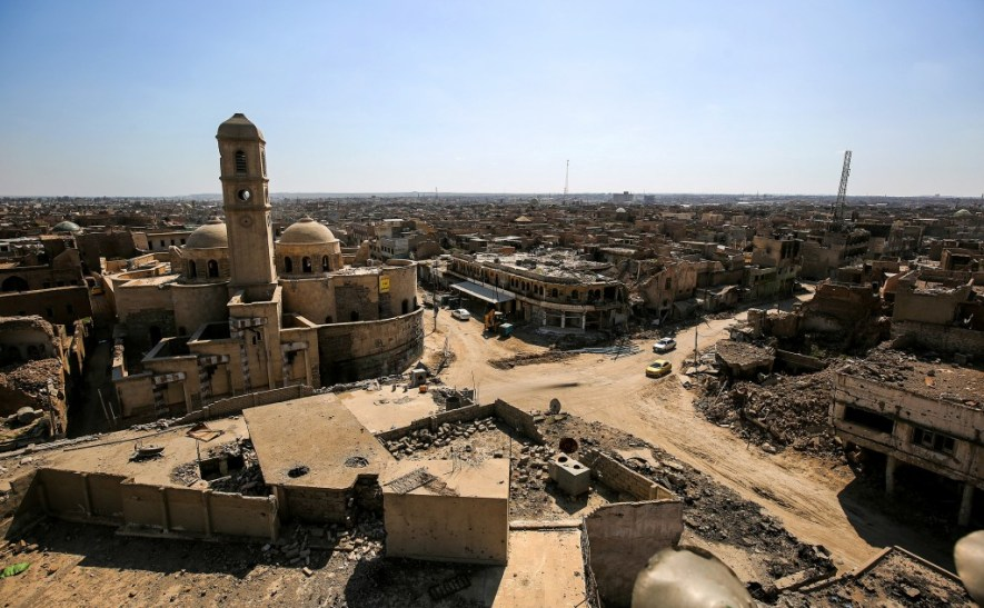 A picture taken on March 14, 2018 shows a view of destruction surrounding the Roman Catholic Church of Our Lady of the Hour (L) in the old city of Mosul, eight months after it was retaken by Iraqi government forces from the control of Islamic State (IS) group fighters. / AFP PHOTO / AHMAD AL-RUBAYE (Photo credit should read AHMAD AL-RUBAYE/AFP/Getty Images)
