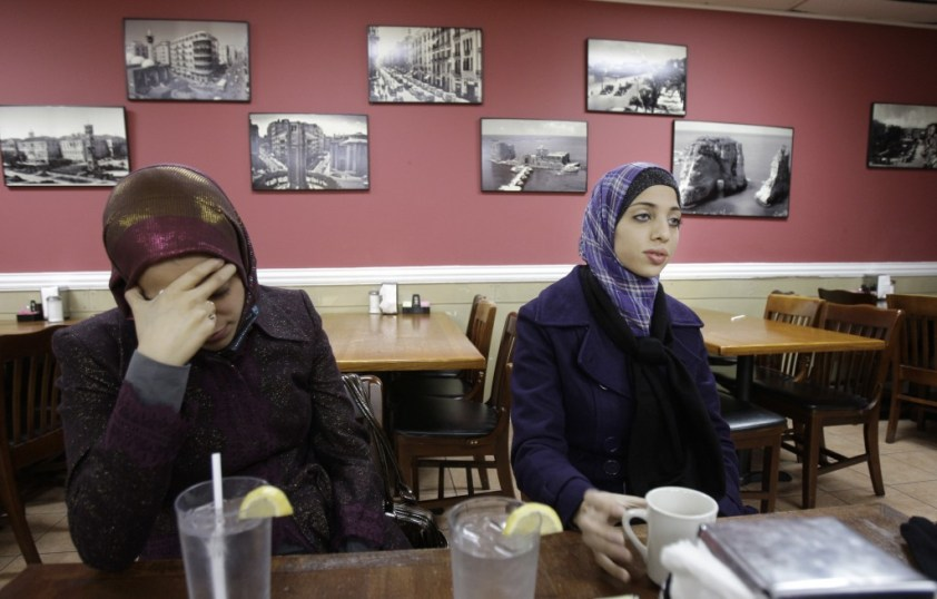 Zaira Abu-Baker, 25, right, holds her head as Noor Elashi, 22, right, speaks during an interview at a cafe in Richardson, Texas, Thursday, Nov. 20, 2008. Elashi and Abu-Baker wait each day while a jury considers whether their fathers ran the biggest terrorism financing scheme in American history. As jurors continue deliberations in the retrial of the Holy Land Foundation families of the charity's five former leaders are desperate for the saga to end. (AP Photo/LM Otero)