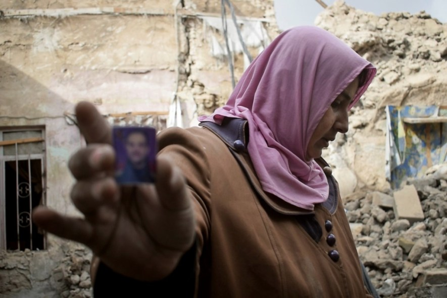 Um Zaman holds a picture of her son, who was killed by a coalition air strike.